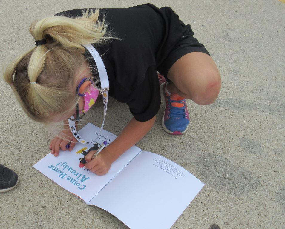 First Grader Signing Her Name